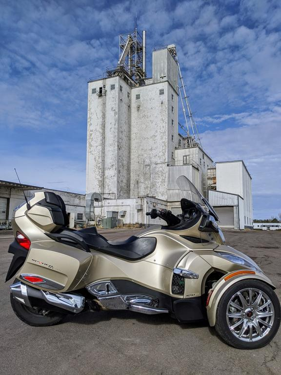 My Spyder in front of the grain elevators in Ellis, SD