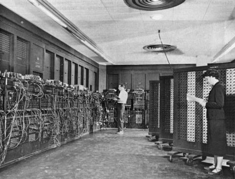 ENIAC (Electronic Numerical Integrator And Computer) in Philadelphia, Pennsylvania Glen Beck (background) and Betty Snyder (foreground) program the ENIAC in BRL building 328